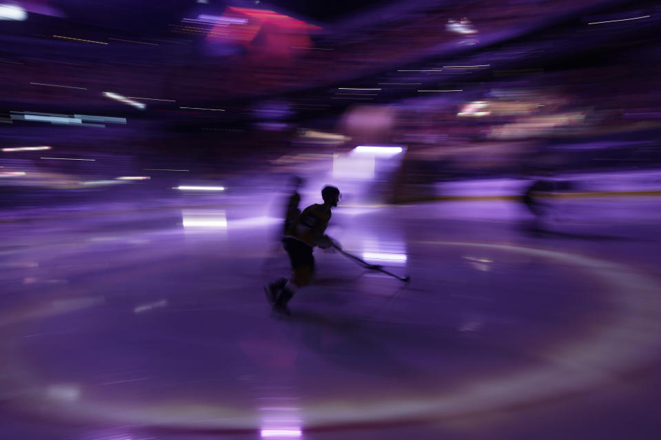 Vegas Golden Knights players warm up before an NHL hockey game against the San Jose Sharks, Wednesday, April 21, 2021, in Las Vegas. (AP Photo/John Locher)