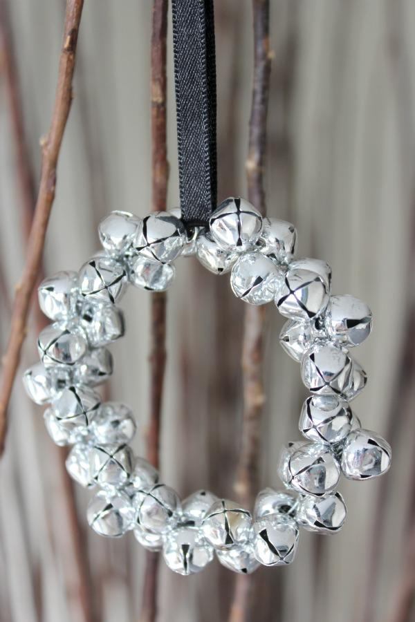"<p>Get into the jingle bell spirit by making a very trendy silver wreath that is sure to make you feel festive. <a rel=""nofollow"" href=""http://satoridesignforliving.com/2012/12/jingle-bell-ornaments/""><em>[Photo: Satori design for living]</em></a> </p>"