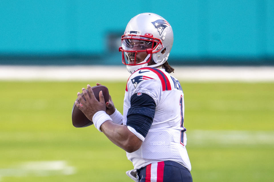 """FILE - New England Patriots quarterback Cam Newton (1) looks to throw the ball against the Miami Dolphins during an NFL football game in Miami Gardens, Fla., in this Sunday, Dec. 20, 2020, file photo. Washington's biggest offseason need is to figure out its quarterback situation. Trade for DeShaun Watson? Sign Cam Newton? Roll with Alex Smith and Kyle Allen? Coach Ron Rivera says """"nothing is off the table."""" (AP Photo/Doug Murray, File)"""