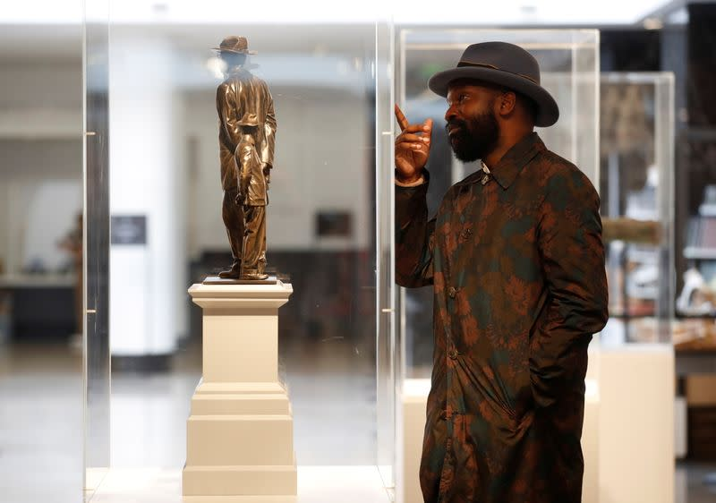 Samson Kambalu stands next to Antelope chosen as one of the Fourth Plinth winners at London's National Gallery