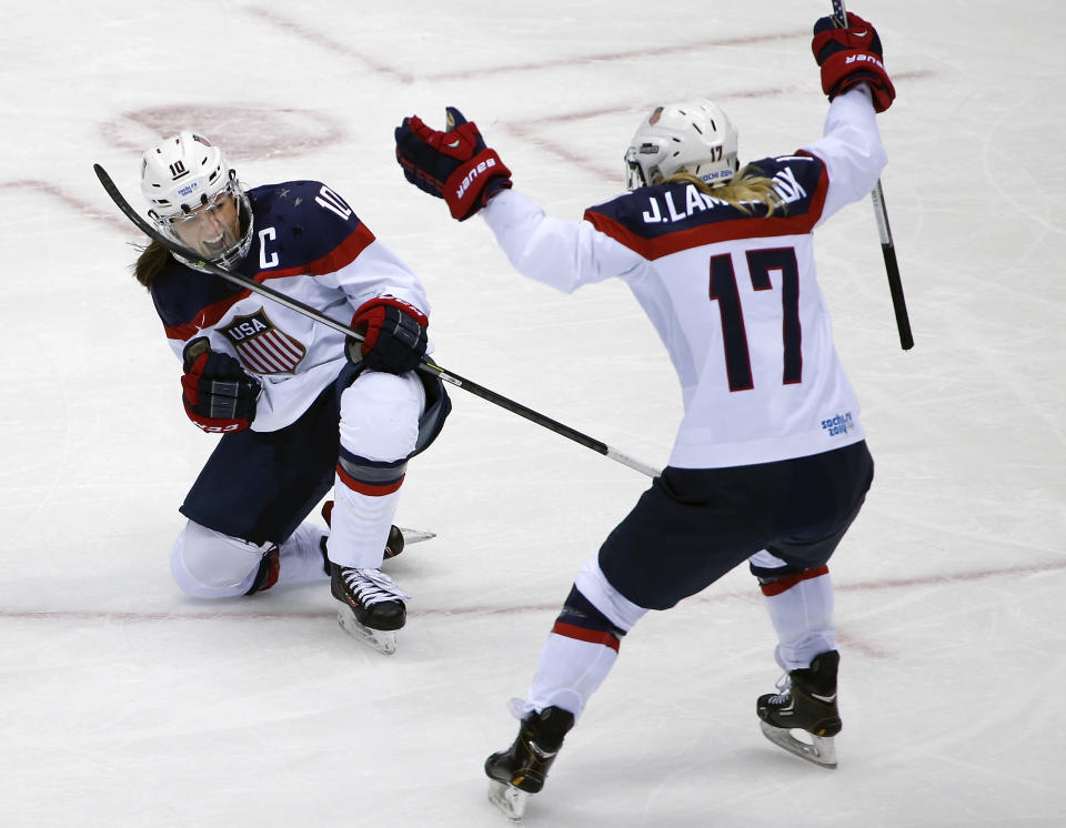 Meghan Duggan of the United States (10) reacts to her goal against Canada as Jocelyne Lamoureux of the United States (17) skates in to congratulate her during the second period of the women's gold medal ice hockey game at the 2014 Winter Olympics, Thursday, Feb. 20, 2014, in Sochi, Russia. (AP Photo/Julio Cortez)