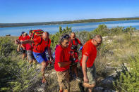 This photo provided by the Croatian Mountain Rescue Service, shows the rescue operation of an unidentified woman who was found on the Adriatic island of Krk on Sept. 12, 2021. Croatian police said Tuesday, Sept. 21, 2021 they are still working to establish the identity of a woman found over a week ago at a northern Adriatic Sea island with no recollection of who she is or where she came from. Police told the Associated Press they are searching the terrain and conducting numerous interviews with residents and tourists or anyone who has information about the woman discovered on the island of Krk on Sept. 12. (HGSS via AP)