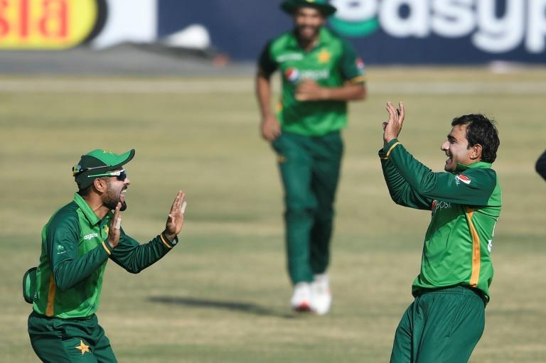 Iftikhar Ahmed (right) celebrates with captain Babar Azam after taking the wicket of Wesley Madhevere
