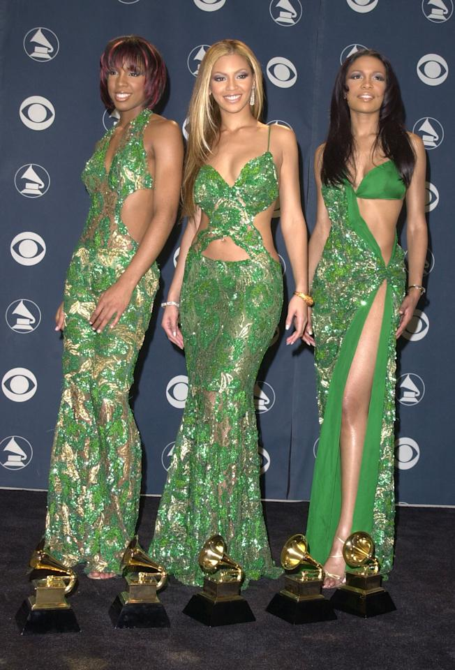 <p>Wearing green cutout gowns at the 2001 Grammys.</p>