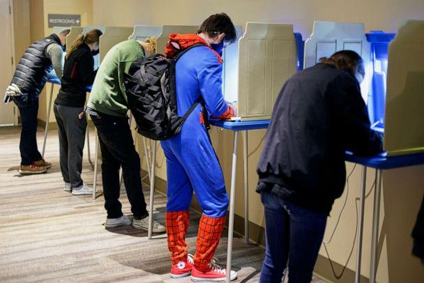 PHOTO: Colin Buckley of Omaha wears a Spiderman suit as he votes early on Halloween, at the Douglas County Election Commission office in Omaha, Neb., Oct. 31, 2020. (Nati Harnik/AP)