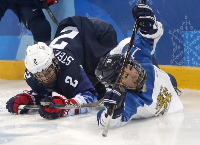 <p>Annina Rajahuhta of Finland (R) reacts after colliding with u2 REUTERS/Kim Kyung-Hoon </p>