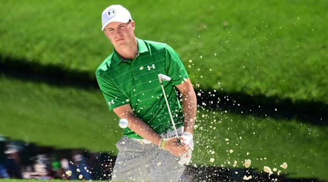 Jordan Spieth plays a shot from a greenside bunker on the 16th hole during a practice round at Augusta National.