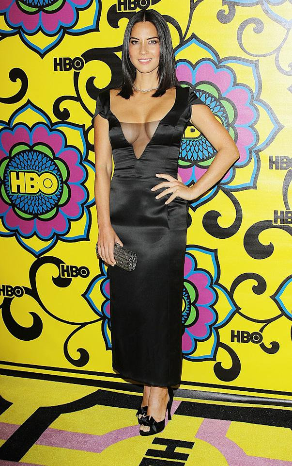Why did Olivia Munn even bother wearing a dress at all? The actress left barely anything to the imagination while posing at an HBO post-Emmy soiree thanks to her ridiculously revealing neckline. On the plus side, by keeping all eyes on top, Munn made sure no one noticed the awkward length of her frock! (9/23/2012)