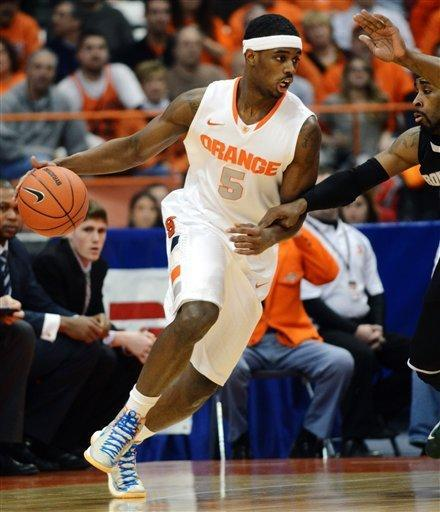 Syracuse's C.J. Fair (5) drives against Providence's LaDontae Henton during the first half in an NCAA college basketball game in Syracuse, N.Y., Wednesday, Feb. 20, 2013. (AP Photo/Kevin Rivoli)