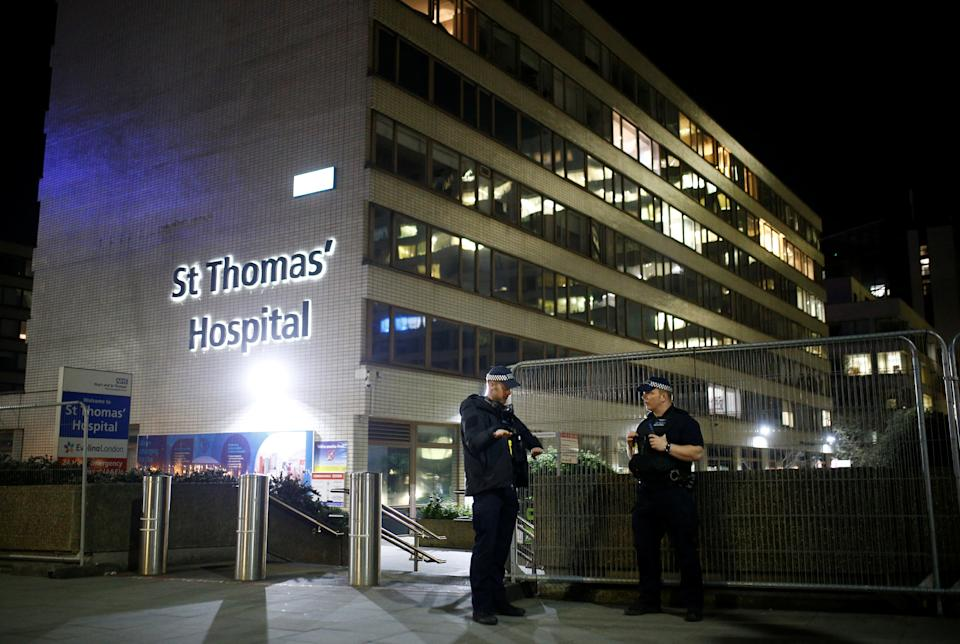 Police officers outside of the St Thomas' Hospital after British Prime Minister Boris Johnson was moved to intensive care after his coronavirus (COVID-19) symptoms worsened and has asked Foreign Secretary Dominic Raab to deputise. London, Britain, April 6, 2020. REUTERS/Henry Nicholls