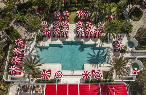 Sweet relaxation with candy cane-themed poolside parasols (Faena Hotel Miami Beach)