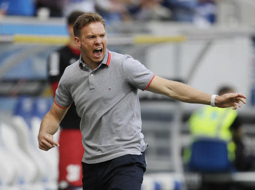 FILE - In this May 12, 2018 file photo Hoffenheim's head coach Julian Nagelsmann celebrates his side's second goal during a German first division Bundesliga soccer match between TSG 1899 Hoffenheim and Borussia Dortmund in Sinsheim, Germany. (AP Photo/Michael Probst, file)