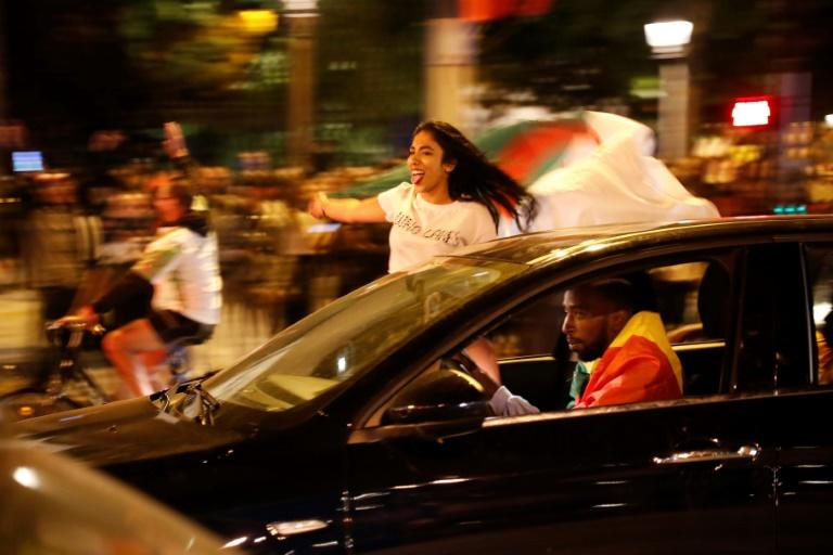 Many fans leaned precariously out of car windows as they waved red, white and green flags (AFP Photo/Zakaria ABDELKAFI)