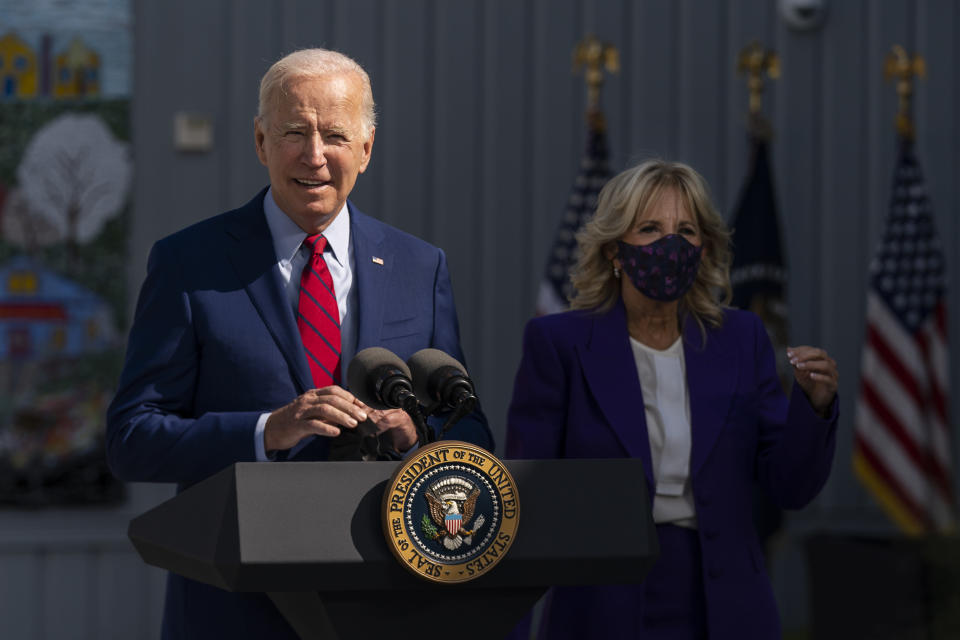 President Joe Biden, with first lady Jill Biden, speaks during a visit at Brookland Middle School in northeast Washington, Friday, Sept. 10, 2021. Biden has encouraged every school district to promote vaccines, including with on-site clinics, to protect students as they return to school amid a resurgence of the coronavirus. (AP Photo/Manuel Balce Ceneta)