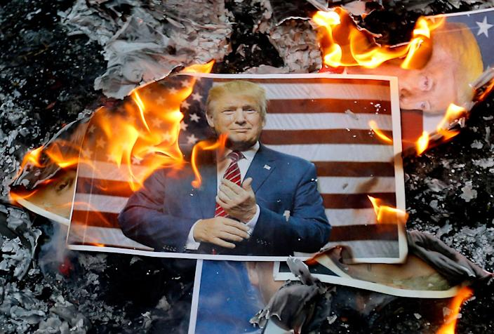 <p>DEC. 11, 2017 – A portrait of US President Donald Trump burns during a demonstration in the capital Tehran, Iran to denounce his declaration of Jerusalem as Israel's capital. (Photo: Atta Kenare/AFP/Getty Images) </p>