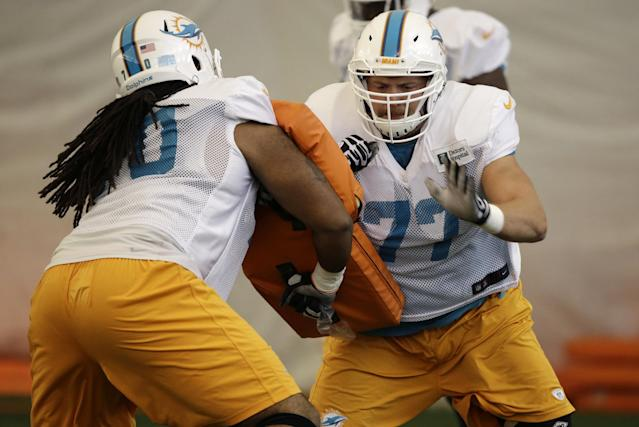 Miami Dolphins guard Dallas Thomas, left, and tackle Tyson Clabo (77) do drills during an NFL football practice, Monday, Nov. 4, 2013, in Davie, Fla. The Dolphins suspended guard Richie Incognito Sunday for misconduct related to the treatment of teammate Jonathan Martin, who abruptly left the team a week ago to receive help for emotional issues. Neither Incognito nor Martin were at practice Monday. (AP Photo/Lynne Sladky)