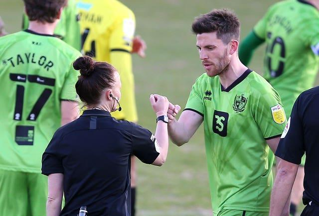 Welch, pictured with Port Vale's Shaun Brisley, was congratulated by all the players after Monday's Sky Bet League Two match at Harrogate