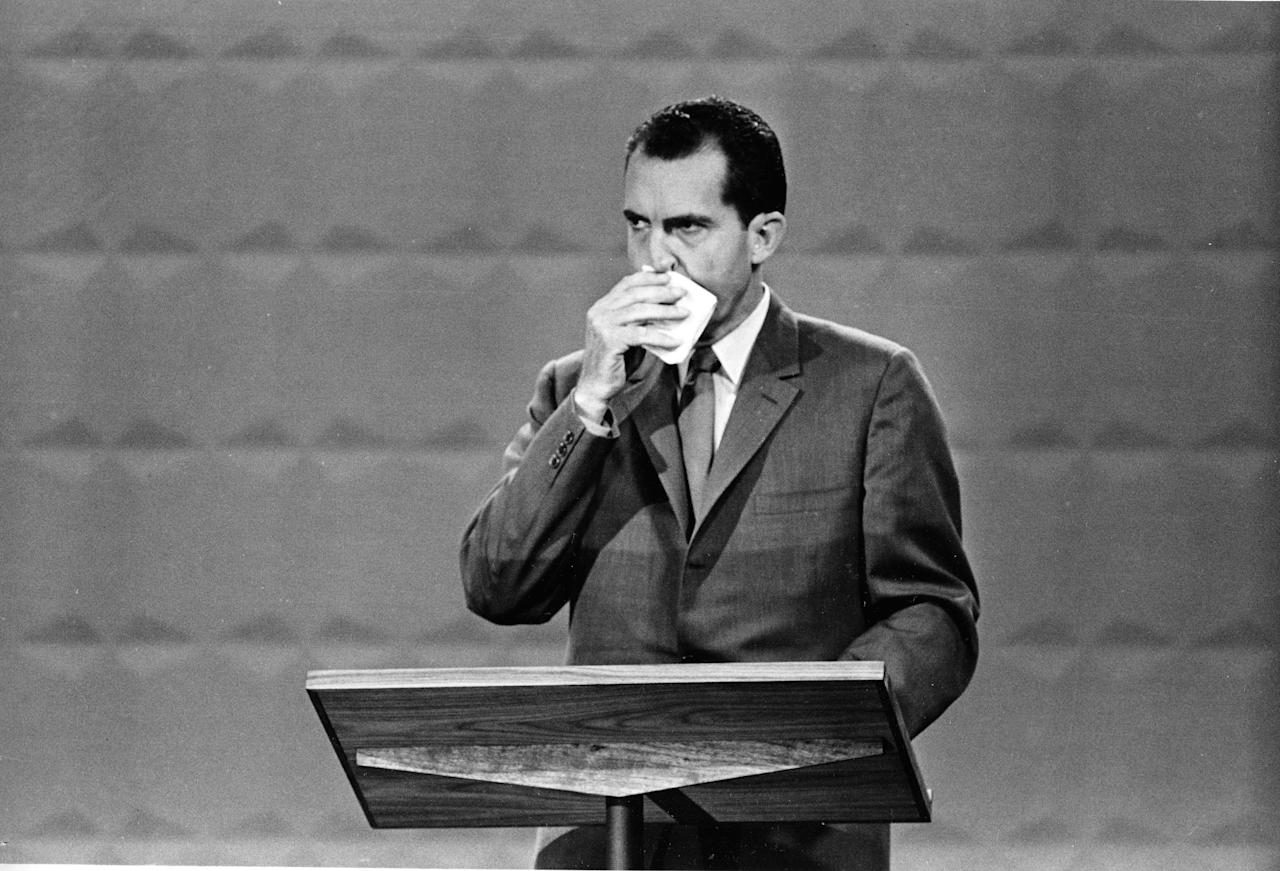 FILE - In this Sept. 26, 1960, file photo U.S. Republican presidential candidate Vice President Richard M. Nixon wipes his face with a handkerchief during the nationally televised first of four presidential debates with Sen. John F. Kennedy, Democratic nominee, in Chicago, Ill., for the first televised debate between presidential candidates in U.S. history. Nixon's profuse sweating on stage with cool-as-a-cucumber rival John Kennedy (not shown) in 1960 proved to be stiff competition in the pantheon of campaign misfires.  (AP Photo/File)