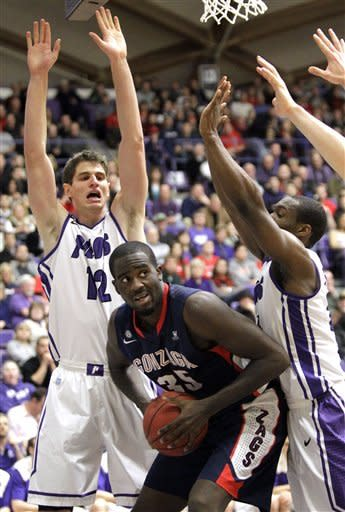 Gonzaga forward Sam Dower, center, looks to pass against Portland's Thomas van der Mars, left, and Derrick Rodgers during the first half of an NCAA college basketball game in Portland, Ore., Thursday, Jan. 17, 2013. (AP Photo/Don Ryan)