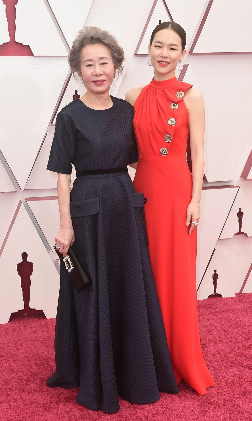 <p>In navy and red gowns. </p>