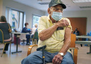 Richard Laslow, 86, of Plum, Pa., prepares to receive a COVID-19 booster shot at Allegheny General Hospital on Pittsburgh's North Side on Thursday, Sept. 23, 2021. The U.S. vaccination drive against COVID-19 stood on the verge of a major new phase as government advisers Thursday recommended booster doses of Pfizer's vaccine for millions of older or otherwise vulnerable Americans — despite doubts the extra shots will do much to slow the pandemic. (Steve Mellon/Pittsburgh Post-Gazette via AP)