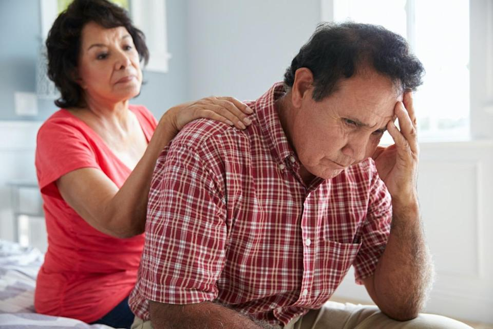Comforting Senior Husband Suffering With Dementia