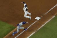 Tampa Bay Rays first baseman Ji-Man Choi tags out Los Angeles Dodgers' Mookie Betts at first base during the eighth inning in Game 3 of the baseball World Series Friday, Oct. 23, 2020, in Arlington, Texas. (AP Photo/David J. Phillip)