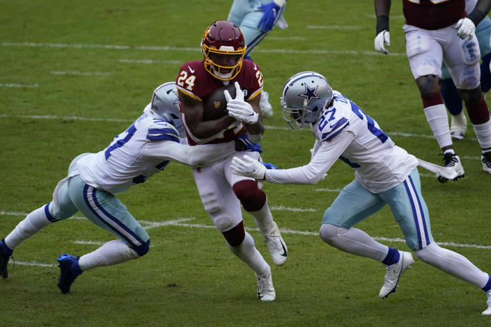 Dallas Cowboys safety Donovan Wilson (37) and cornerback Trevon Diggs (27) fail to stop Washington Football Team running back Antonio Gibson (24) from scoring a touchdown during the first half of an NFL football game, Sunday, Oct. 25, 2020, in Landover, Md. (AP Photo/Susan Walsh)