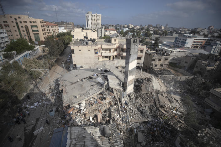 A top view shows the remains of a six-story building which was destroyed by an early morning Israeli airstrike, in Gaza City, Tuesday, May 18, 2021. Israel carried out a wave of airstrikes on what it said were militant targets in Gaza, leveling a six-story building in downtown Gaza City, and Palestinian militants fired dozens of rockets into Israel early Tuesday, the latest in the fourth war between the two sides, now in its second week. (AP Photo/Khalil Hamra)