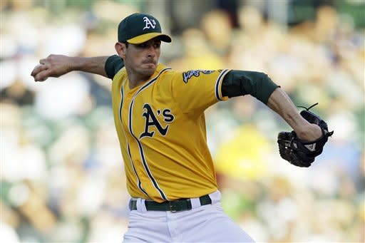 Oakland Athletics starting pitcher Brandon McCarthy throws against the Los Angeles Dodgers during the first inning of their baseball game in Oakland, Calif., Tuesday, June 19, 2012. (AP Photo/Eric Risberg)