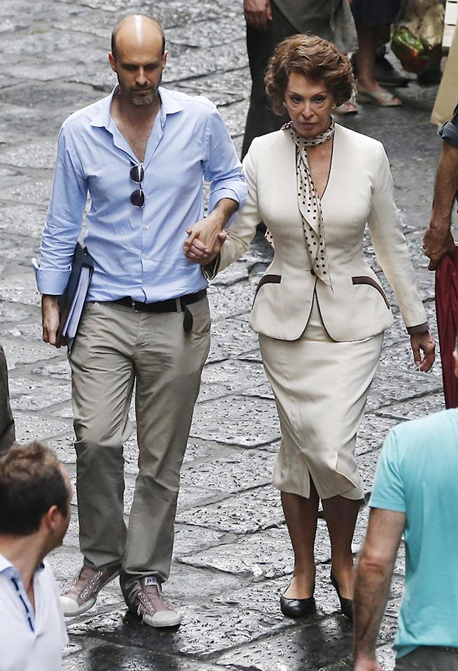 Sophia Loren with Enrico Loverso on a film set 'La Voce Umana' in Naples, the film is being directed by her son Edoardo Ponti.