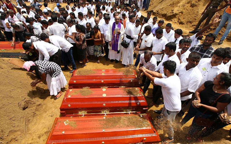 A funeral ceremony for the victims of the Easter Sunday terror attacks in near the devastated church of St Sebastian in Negombo, Sri Lanka - Anadolu
