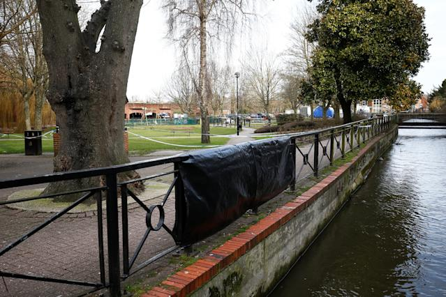 Tarpaulin covers a section fencing near to the park bench where former Russian intelligence agent Sergei Skripal and his daughter Yulia were found after they were poisoned, in Salisbury, Britain. March 14, 2018. REUTERS Henry Nicholls