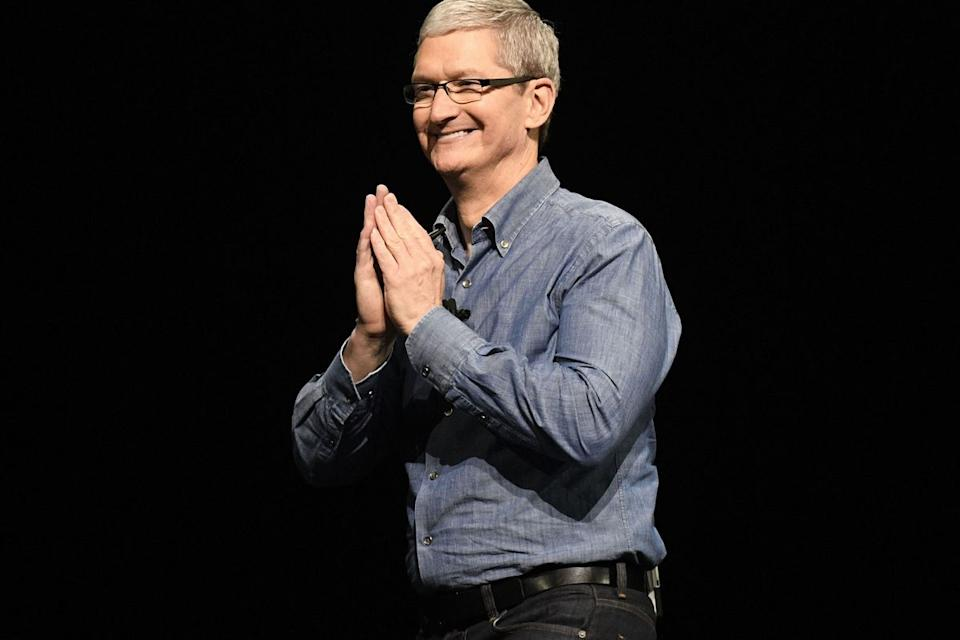 Tim Cook, chief executive officer of Apple Inc., gestures to attendees as he concludes his keynote during the Apple World Wide Developers Conference (WWDC) in San Francisco, California, U.S., on Monday, June 13, 2016. Apple Inc.'s mobile-payment service Apple Pay will now work on websites, a long-awaited feature that will pit the company directly against companies such as PayPal Holdings Inc. *** Local Caption *** Tim Cook