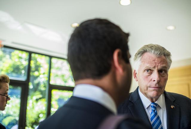 Virginia Gov. Terry McAuliffe huddles with staff before delivering a speech during the 2017 Center for American Progress Ideas Conference. (Photo: Melina Mara/The Washington Post via Getty Images)