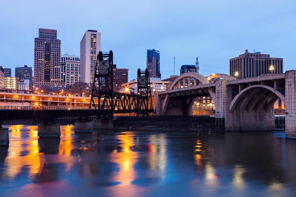 cityscape photo of river, bridge, and buildings in St. Paul, Minnesota
