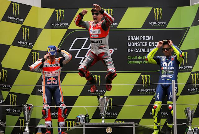 MotoGP - Grand Prix of Catalunya - Circuit de Barcelona-Catalunya, Barcelona, Spain - June 17, 2018 Ducati Team's Jorge Lorenzo celebrates after winning the race with second placed Repsol Honda Team's Marc Marquez and third placed Movistar Yamaha MotoGP's Valentino Rossi REUTERS/Jon Nazca