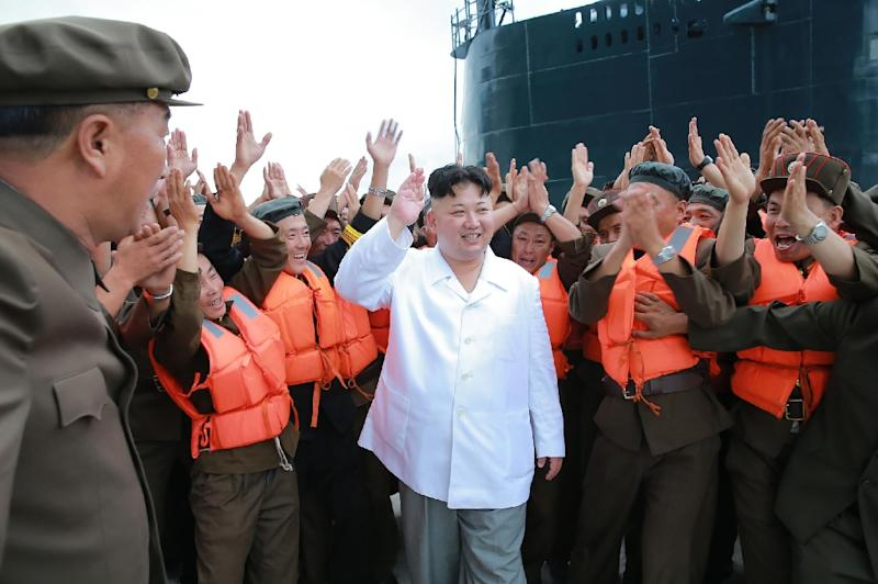 North Korean leader Kim Jong-Un (C) arrives to inspect a test-fire of strategic submarine-launched ballistic missile at an undisclosed location, on August 25, 2016 (AFP Photo/KCNA via KNS)