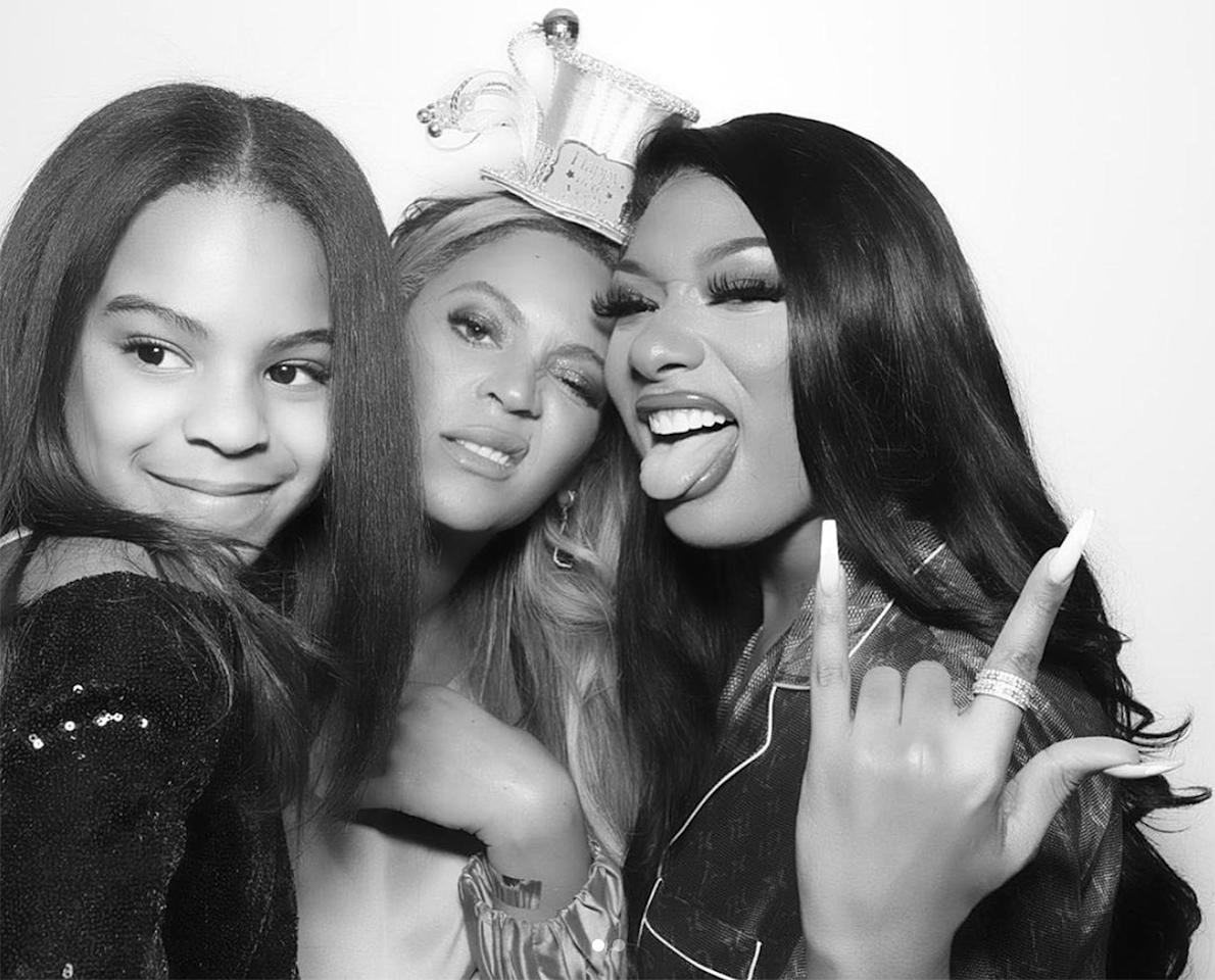 """Blue made us do a double-take in this photo booth pic of her, Beyoncé and """"Hot Girl Summer"""" rapper Megan Thee Stallion. The trio <a href=""""https://people.com/parents/blue-ivy-beyonce-megan-thee-stallion-new-years-eve/"""">celebrated New Year's Eve 2019 together</a> and almost-8-year-old Blue looked all grown up — and like the spitting image of her mom — with straight hair and a soft smile."""