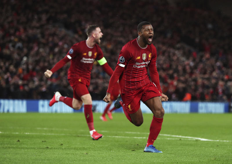 Liverpool's Georginio Wijnaldum celebrates after scoring his side's opening goal during a second leg, round of 16, Champions League soccer match between Liverpool and Atletico Madrid at Anfield stadium in Liverpool, England, Wednesday, March 11, 2020. (Peter Byrne/PA via AP)