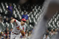 St. Louis Cardinals' Nolan Arenado throws out a runner at first base during the seventh inning of a baseball game against the Milwaukee Brewers, Monday, Sept. 20, 2021, in Milwaukee. (AP Photo/Aaron Gash)