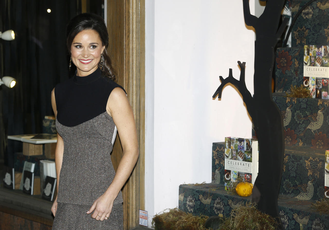 """Pippa Middleton, sister to the Duchess of Cambridge, formerly known as Kate Middleton, poses for the media as she arrives at a bookshop to promote her new book """"Celebrate: A Year of British festivities for families and friends"""", in London Thursday, Oct. 25, 2012. (AP Photo/Kirsty Wigglesworth)"""