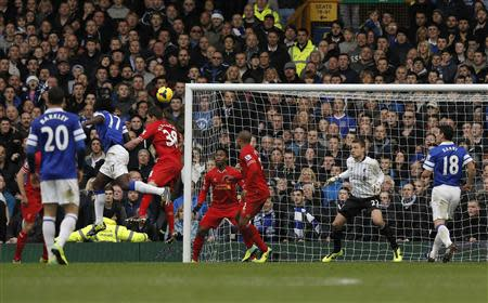 Everton's Romalu Lukaku (L) scores a goal against Liverpool during their English Premier League soccer match at Goodison Park in Liverpool, northern England November 23, 2013. REUTERS/Phil Noble