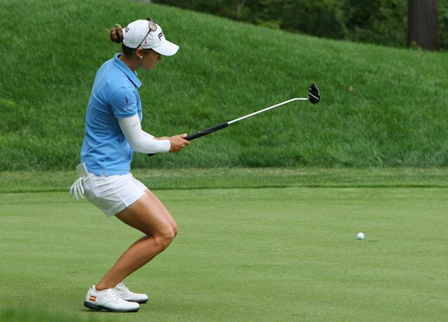 Azahara Munoz, of Spain, reacts as she misses her putt on the seventh hole during final-round play at the Canadian Pacific Women's Open golf tournament in London, Ontario, Sunday, Aug. 24, 2014. (AP Photo/The Canadian Press, Dave Chidley)