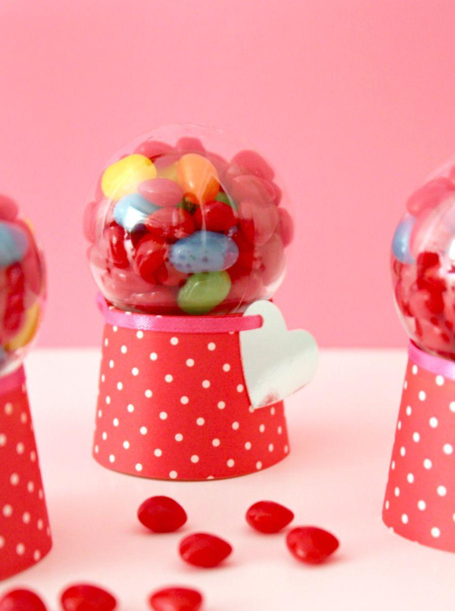 """<p>Make these mini candy dispensers with deceptively ordinary and easy-to-find materials: baking cups and plastic ornaments serve as the key supplies.</p><p><em><a href=""""https://www.whitehousecrafts.net/post/2018/01/10/diy-valentine-candy-dispenser-machines"""" rel=""""nofollow noopener"""" target=""""_blank"""" data-ylk=""""slk:Get the how-to at White House Crafts»"""" class=""""link rapid-noclick-resp"""">Get the how-to at White House Crafts»</a></em><strong><br></strong></p><p><strong>RELATED: </strong><a href=""""https://www.goodhousekeeping.com/holidays/valentines-day-ideas/g1409/best-valentines-day-chocolates/"""" rel=""""nofollow noopener"""" target=""""_blank"""" data-ylk=""""slk:40 Sweetest Valentine's Day Chocolates and Candy to Buy Your Loved Ones"""" class=""""link rapid-noclick-resp"""">40 Sweetest Valentine's Day Chocolates and Candy to Buy Your Loved Ones</a><br></p>"""