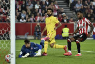 Liverpool's Mohamed Salah, center, scores his side's second goal during the English Premier League soccer match between Brentford and Liverpool at the Brentford Community Stadium in London, Saturday, Sept. 25, 2021. (AP Photo/Rui Vieira)