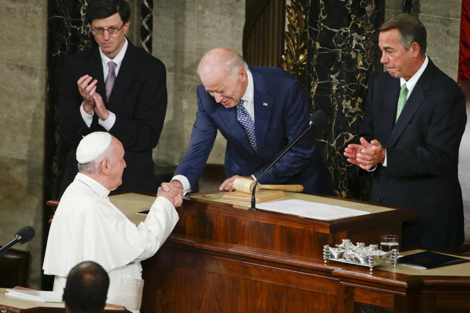 FILE - In this Sept. 24, 2015, file photo Vice President Joe Biden shakes hands with Pope Francis on Capitol Hill in Washington, prior to the pope's address to a joint meeting of Congress, making history as the first pontiff to do so. House Speaker John Boehner of Ohio is at right. President Joe Biden is set to meet Pope Francis when he visits the Vatican later this month as part of a five-day swing through Italy and the U.K. for global economic and climate change meetings. (AP Photo/Pablo Martinez Monsivais, File)