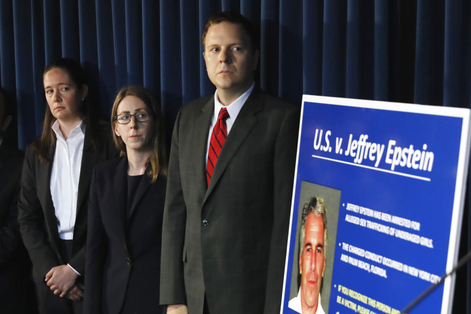 Assistant U.S. Attorney Maurene Comey, left, daughter of former FBI Director James Comey, listens during a news conference, in New York, Monday, July 8, 2019. Federal prosecutors announced sex trafficking and conspiracy charges against wealthy financier Jeffrey Epstein. Court documents unsealed Monday show Epstein is charged with creating and maintaining a network that allowed him to sexually exploit and abuse dozens of underage girls.(AP Photo/Richard Drew)