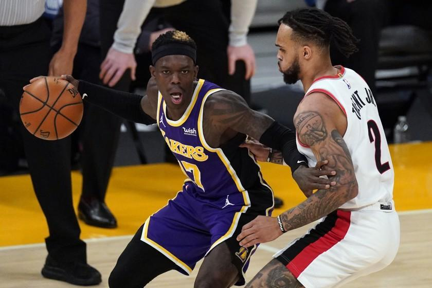 Portland Trail Blazers guard Gary Trent Jr. (2) defends against Los Angeles Lakers guard.