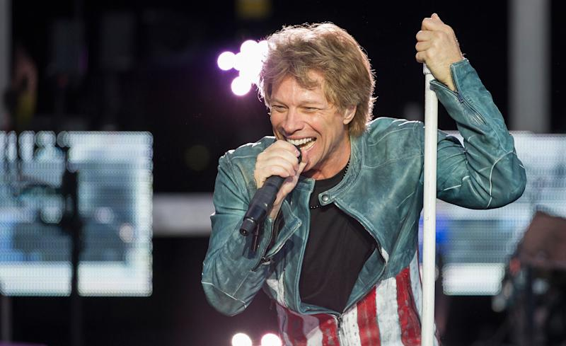 "FILE - In this May 18, 2013, file photo shows singer Jon Bon Jovi performing on stage as part of his ""Because we can"" tour in Munich, southern Germany. Bon Jovi are waiving their performance fee for a concert in Madrid as a gesture to their Spanish fans hit hard by the country's severe economic crisis. (AP Photo/dpa, Marc Mueller, file)"